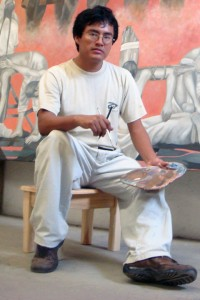 Cunjamá en una de sus obras plasmadas en los muros del Poder Judicial del Estado de Chiapas con el artista Gabriel Gallegos en el 2010.