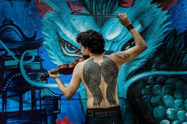 David y su violín. David y sus alas, y sus sueños... / 2015.  Foto: Ariel Silva
